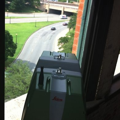 The Leica ScanStation on the sixth floor of the former Texas School Book Depository overlooking the motorcade route through Dealey Plaza.